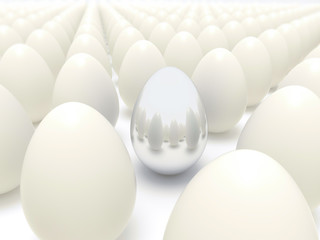 Silver egg in rows of normal eggs - Business Easter time concept