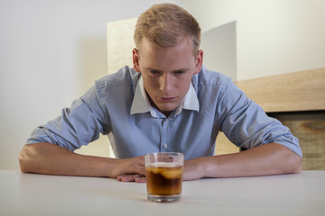 Businessman struggling with alcoholic problem