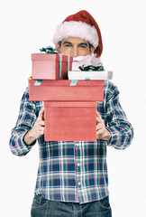Man holding Christmas gifts. Isolated on white