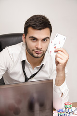 Online Poker player holding two aces wearing shirt and tie