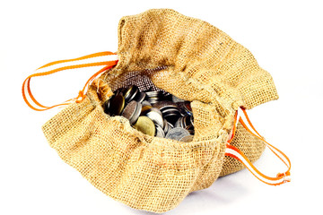burlap sack full of coins on white background.