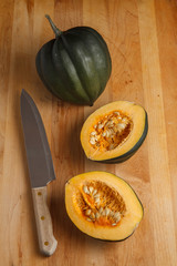 Acorn Squash on Cutting Board with Chef Knife
