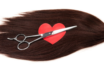 hair, heart shape and clippers on white background