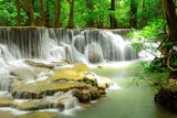 Waterfall in tropical deep forest at Huay Maekhamin - 69027294