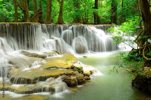 Fototapeta Waterfall in tropical deep forest at Huay Maekhamin