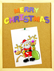 Merry Christmas phrase on a corkboard