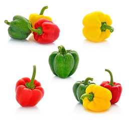 red green yellow pepper on white background