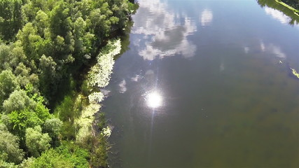 Bright sun in  form of reflection in  river water. Aerial
