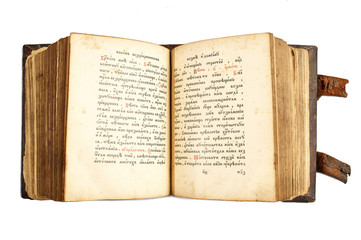 Open old cyrillic book isolated on white