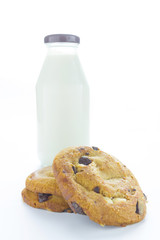 Chocolate chip cookies with milk in bottles