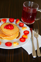 Pancakes with fruits and tea