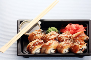 delivery service Japanese food rolls in plastic box