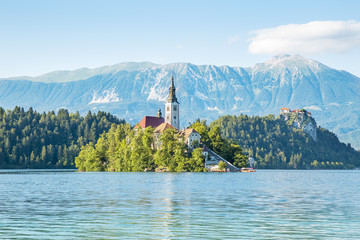Church on an island and castle on rock in Bled