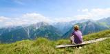 Boy enjoying his view in high mountains