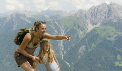 Mother and daughter in the mountains