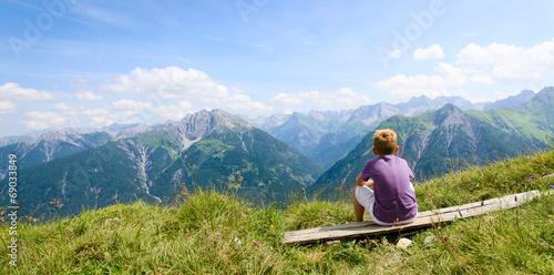 Boy enjoying his view in high mountains © bramgino