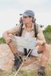 Leinwandbild Motiv Hiking man with map on mountain terrain