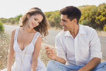 Couple sitting on countryside landscape