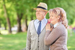 Lovely mature couple standing in park