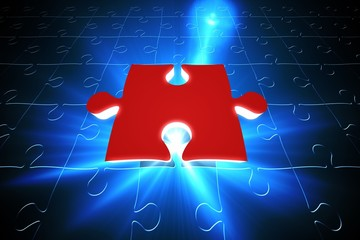 Red jigsaw piece on blue puzzle