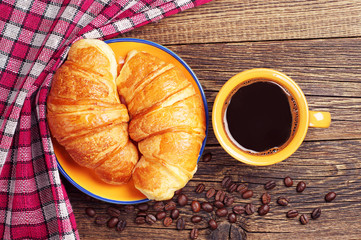 Cup of coffee and two croissant