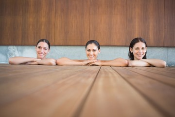 Cheerful young women in swimming pool