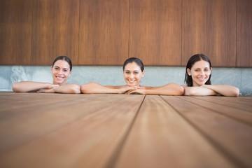 Cheerful young women in swimming pool