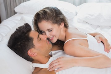 Romantic couple in bed at home
