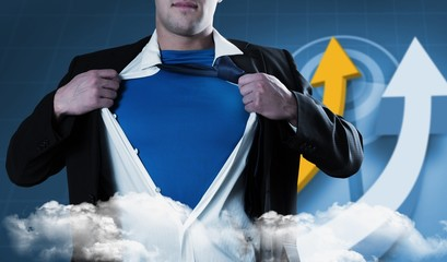 Composite image of businessman opening his shirt superhero style