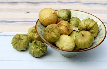 Tomatillos in blue bowl