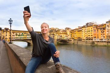 Lady taking selfie in Florence.
