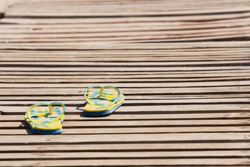 sandals on wooden floor