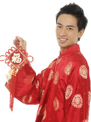 chinese young man with tradition clothing holding lucky Symbol
