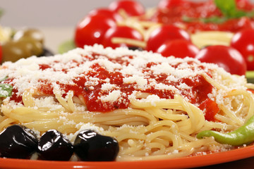 spaghetti with olives and sauce closeup