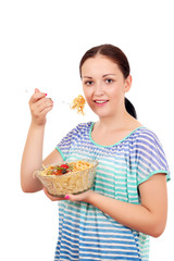 beautiful teenage girl eating spaghetti