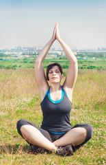 Beautiful plus size woman doing yoga