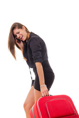 upset business woman with travel suitcase