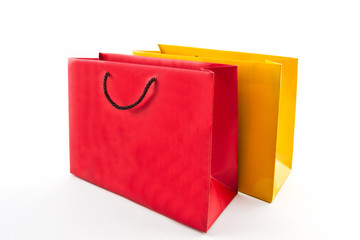 Blank red and yellow paper shopping bag .