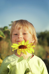 Happy boy with sunflower