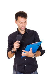 handsome man giving speech on microphone reading notes