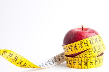 Manzana con cinta metrica