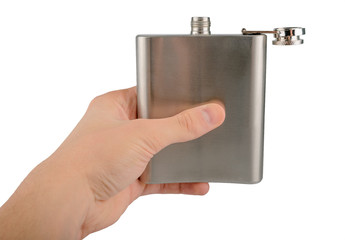 Male hand holding stainless hip flask isolated on a white