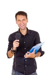 young business man with notes announcing on microphone