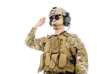 Soldier in military uniform  saluting over white background