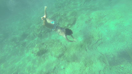 Lady Diving Underwater And Showing Board