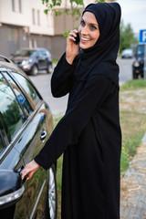 Young Arabian Woman Next To Car