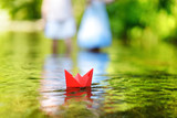 Fototapety A paper boat floating on a river