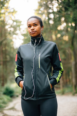 Portrait of female runner in a forrest