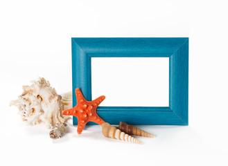 Blue photoframe with seashells near it, isolated on white backgr