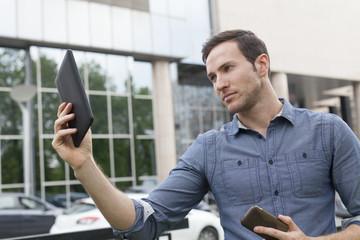 Man holding i-pad tablet computer